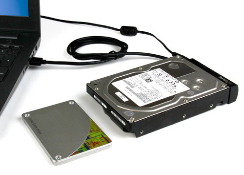 ?An external solid-state drive connected to a laptop through the USB 3.1 to SATA adapter