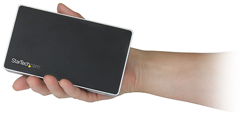 The HDMI docking station is about the size of one's hand, the image highlights the dock's compact and palm-sized design